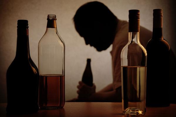 man drinking heavily
