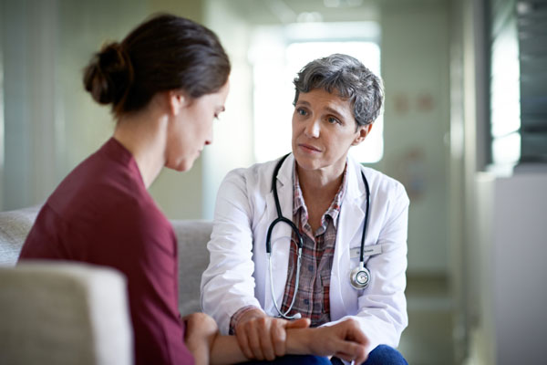doctor with patient in medical detox